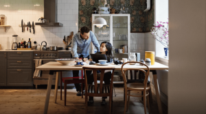 Couple speaking at kitchen table