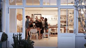 Friends celebrating in kitchen